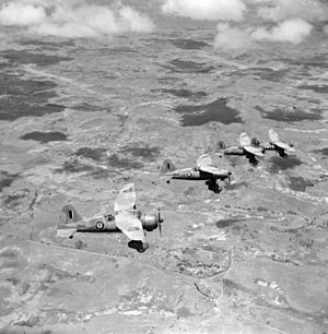 Westland Lysander - December 1942. Four Lysander Mk IIIAs of No. 1433 Flight RAF, based at Ivato, over a typical Madagascar landscape, shortly after the official end of the Madagascar campaign. (Photographer: Sgt J.D. Morris).