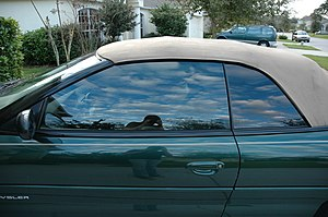 Window film - Window tint on a convertible in America. Tint on the front window is lighter than on the back window because of window tint laws.