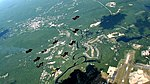 Wingsuit Formation in the Shadow of a Cloud (6367630195).jpg