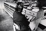 Woman Working in a Mail Processing Center (2536001835).jpg