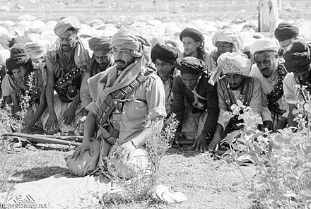 Muhammad al-Badr praying with his guards. Yemen 1962 20.jpg