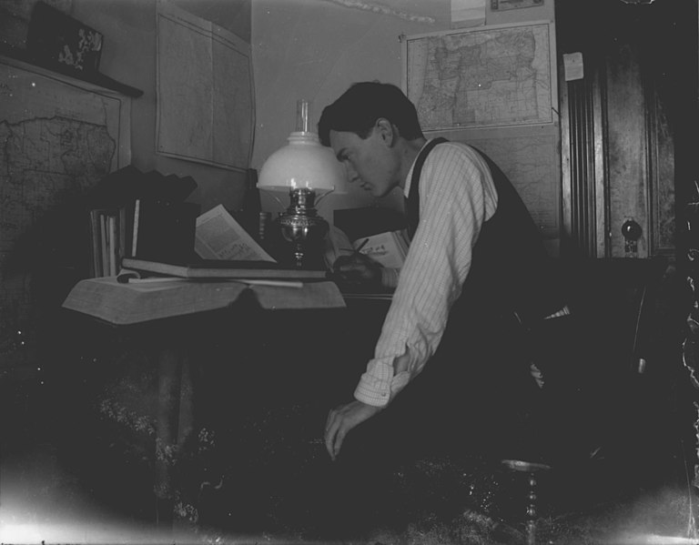 File:Young man sitting at desk (3946087716).jpg
