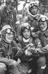 May 26, 1945. Corporal Yukio Araki, holding a puppy, with four other pilots of the 72nd Shinbu Squadron at Bansei, Kagoshima. Araki died the following day, at age 17, in a suicide attack on ships near Okinawa.