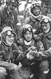 Photo shows Corporal Yukio Araki holding a puppy with four other young men of the 72nd Shinbu Corps around him. An Asahi Shimbun cameraman took this photo on the day before the departure from Bansei Air Base. Araki died at the age of 17 in a suicide attack on US ships near Okinawa on May 27, 1945.
