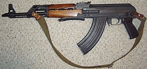 Assault weapon - A semi-automatic Zastava M70AB2 rifle with a pistol grip, folding stock, and a bayonet lug.
