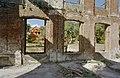 Zicht op linker zijgevel commandantswoning op het fortcomplex, tijdens restauratie, gezien door venster van ruïne gebouw 1790 - Paramaribo - 20377886 - RCE.jpg