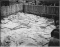 """""""Ready for a concrete pour in block 14G, showing cleaned bedrock and form work on which are mounted the metal... - NARA - 294147.tif"""