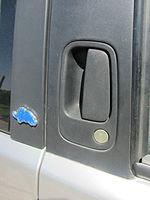 Outside Door Handle Of A 1996 Lancia Y, Hidden On The B Pillar.