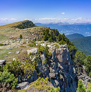 Porphyr rocks on the alpine pasture Resciesa in Gherdëina, South Tyrol - Unesco World Heritage Dolomites, Puez-Geisler Nature Park.