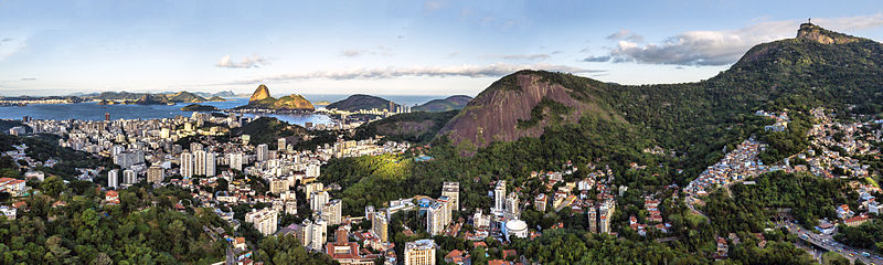 Aerial panorama of Santa Teresa, a neighborhood of Rio de Janeiro, with the Christ the Redeemer, Tijuca Forest and Sugarloaf Mountain, in the background.