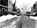 1st Ave vicnity of Pike St after a snowfall, 1916 (SEATTLE 1412).jpg