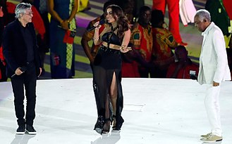 Anitta (singer) - Anitta, (center) with singers Caetano Veloso (left) and Gilberto Gil (right) performing at the 2016 Summer Olympics opening ceremony