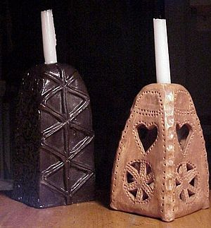 Julleuchter - Two Turmleuchter type ceramic candle-holders (2008 photograph). The right one replicates the design of the SS Julleuchter, itself based on an early modern candle-holder from southern Sweden.