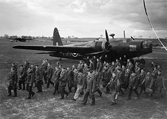 No. 75 Squadron RAF - 75 Squadron aircrew with a Wellington Mk I in the background at RAF Feltwell before a night raid on Hamburg
