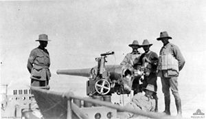 AIF troops with QF 4 inch Mk I-III gun 1914 AWM P00326.017.jpeg