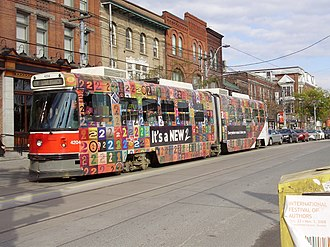 Wrap advertising - A streetcar in Toronto wearing a temporary wrap, advertising CBC Radio 2.