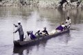 ASC Leiden - F. van der Kraaij Collection - 02 - 030 - African men, women and a child in a hollowed canoe crossing the Mano River - Lofa County, Liberia, 1976.tiff