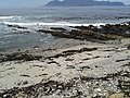 ASC Leiden - Rietveld Collection - 32 - Stone and sandy beach overlooking the Table Mountain across the sea - 2015.jpg