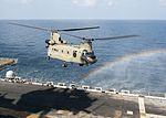A CH-47 Chinook helicopter prepares to land on the flight deck of USS Makin Island. (31744638245).jpg