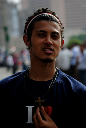 Mohamed, a Muslim wearing the cross in solidar...