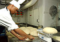 A Seaman of Fort Worth prepares dinner rolls in the Bake Shop.jpg