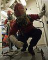 A U.S. Coast Guard fire team aboard the maritime security cutter USCGC Bertholf (WMSL 750) prepares to enter an area during a gas leak drill as part of Arctic Shield 2012 in the Arctic Ocean 120829-G-VS714-118.jpg