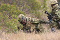 A member of the Japanese Ground Self-Defense Force, left, shouts commands during a patrolling exercise at Marine Corps Base Camp Pendleton, Calif., June 12, 2013, during exercise Dawn Blitz 2013 130612-M-JU912-089.jpg