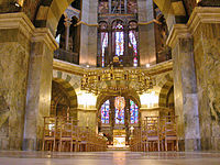 The pinnacle of Carolingian architecture: the palatine chapel at Aachen, Germany.