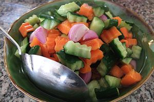 Acar - Acar made of cucumber, carrot and shallot bits in vinegar