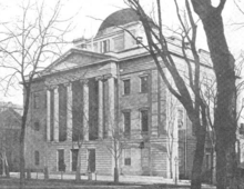 Old black-and-white photo shows a stone building with four columns in front and a domed roof.