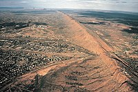 This view shows the transport links passing through Heavitree Gap in the MacDonnell Ranges found adjacent to the town