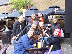 A Band - The A Band at the Edinburgh Fringe Festival, 2009. Back row: Pete Herring, Karl Waugh, Stewart Greenwood. Middle:Stewart Keith, Seth Cooke, Gardyloo SPeW. Front: Andrew Fletcher, Greta Pistaceci.