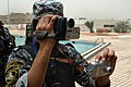 An Iraqi National Police officer pulls double duty as a photographer and a videographer during the ribbon cutting ceremony at the al Jadida Public Swimming Pool in Baghdad, Iraq, June 7, 2008 080607-A-YE931-135.jpg