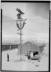 Ansel Adams Manzanar - Line crew at work in Manzanar - LOC ppprs-00222.jpg