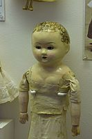 Antique doll with no dress (25448768293).jpg