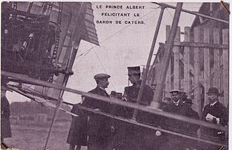 1909 in aviation - The then Prince Albert of Belgium congratulates baron Pierre de Caters at the Antwerp Aviation Week (23 October- 2 November)