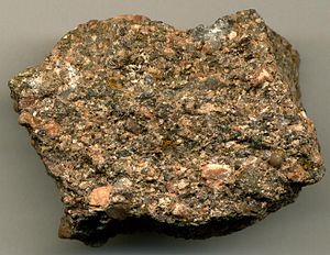 Arkose with K-feldspar (pinkish-orangish) and quartz (gray) grains.jpg