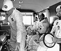 Armstrong, Aldrin, and Collins (left to right) in the transfer van returning from the pad with suit tech Joe Schmidt after a Countdown Demonstration Test.jpg