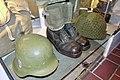 Army uniforms of Norway. Field uniform (feltuniform) M1951 German Stahlhelm helmet (tyskerhjelm) Laced ankle boots Anklets gaiters (gamasjer) American helmet Mesh net cover Backpack etc. Armed Forces Museum (Forsvarsmuseet) Oslo 2019-0.jpg