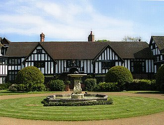 Ascott House - The centre of the entrance front, the oldest part of the house. A beam over the present front door (behind the fountain) gives the date 1606