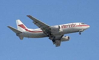 Aurela - Aurela Boeing 737-300 landing at Vilnius Airport (VNO).