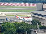 BH-1900Cs in Front of Songshan AFB Hangar 20120707a.jpg
