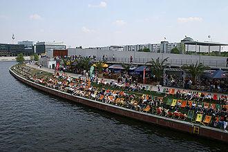 Deckchair - People relaxing on deckchairs at the River Spree near Berlin Hauptbahnhof, Berlin 2007