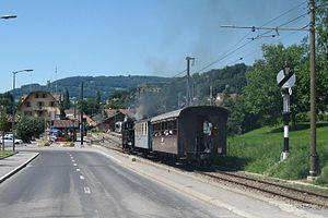 Blonay - Train of the Blonay–Chamby Museum Railway in the foreground of the railway station Blonay, 2011