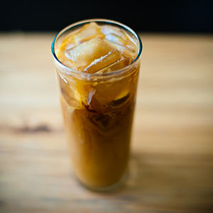 "Iced coffee - Iced coffee served in the ""Kyoto style"", where room temperature water is dripped over coffee grounds for eight hours, and then diluted over ice"