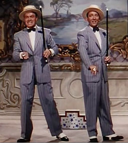 "Hope and Bing Crosby sing and dance during ""Chicago Style"" in Road to Bali (1952) Bob Hope and Bing Crosby in Road to Bali.jpg"