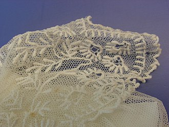 Limerick lace - Detail of an infant's bodice in Limerick lace tambour style