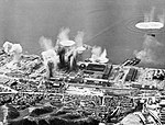 Bomb plumes rising during the naval Grumman Avenger attack on Fuge, Honshu in July 1945 A30152.jpg