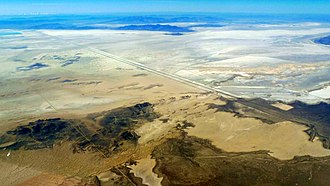 Bonneville Salt Flats - Aerial view of the Bonneville Salt Flats in 2015; the race track is located in the upper left
