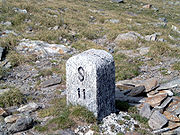 Border stone at Passo San Giacomo between Val Formazza in Italy and Val Bedretto in Switzerland